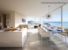 Beautiful penthouse design with ocean views and clean contemporary kitchen and dining room