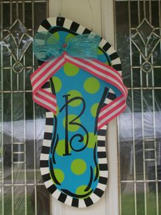 Single flip flop door hanger w/initial. $20 w/painted straps...or $23 as pictured w/ribbon straps & bow. Can be customized w/any colors & personalized w/any initial. Check out my facebook page (Blue Pickle Designs) for lots of other items & to place order!