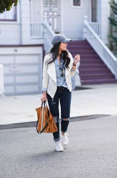 For a casual fall day, wear a fitted boyfriend oxford shirt with jeans and sneakers. Complete the carefree look with a baseball hat and tote bag. Here blogger The Fancy Pants Report styles her Gap oxford shirt.