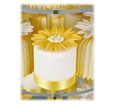 Little White Cake Topped With Huge Yellow Daisy