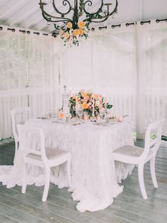 white and peach wedding inspiration, photo by Rachel May Photography http://ruffledblog.com/clifton-inn-wedding-inspiration #weddingideas #tablescape