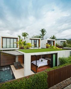 An amazing example of a modern-era green roof house in a suburban coastal environment