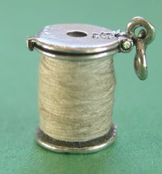 RARE VINTAGE STERLING SILVER COTTON REEL or SPOOL OF THREAD CHARM ~ NUVO ~ Opens | 195 usd (!?)