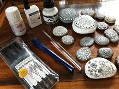 I have been painting pebbles and exploring inks and supplies.  Some of the tools and inks I used for painting and drawing these pebbles: Black Faber Castell Pitt artist pens, Staedtler 0.4 technical pen with white Staedtler ink, 00 synthetic Round brush with white Daler-Rowney acrylic ink or white Pergamano indelible drawing ink.