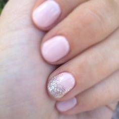 Baby pink nails w/ a sparkly accent nail