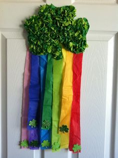 Saint Patrick's day Crafts: Make your own similar door or window decoration by adhering some colored ribbons onto a dollar store shamrock.  Very easy and cute.