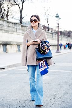 Miroslava Duma paired her wide-leg jeans with a practical yet stylish wedge mule // #Denim
