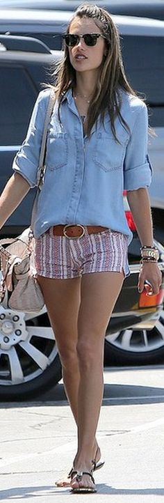 Who made Alessandra Ambrosios denim button down top, print shorts, black sunglasses, and brown leather belt?