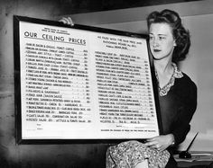Yvonne Pagel of the Office of Price Administration shows a board that had to be posted in all restaurants in August 1944. The list contained 40 basic food items selected by the office. Each restaurant had to fill in the price it charged for those 40 items during the base period of April 4-10, 1943. THE WORLD-HERALD