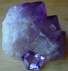 Raw and cut amethyst crystals