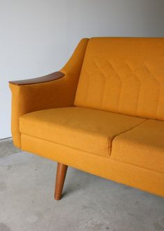 mid-century sofa with teak arm rests