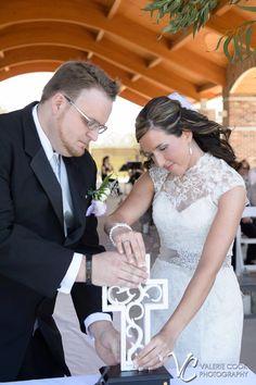 Unity cross ceremony. We love the bride's gorgeous lace wedding dress!