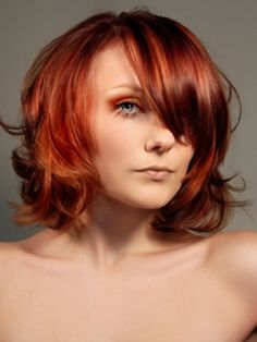 red medium-length bob.