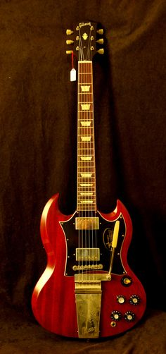 would love to see that price tag: Gibson SG standard with lire vibrola.