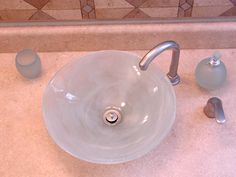A DIY vessel sink from a glass bowl, using a diamond hole saw.