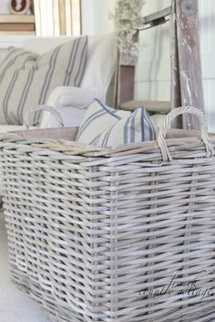 Basket for pillows Living room Whitewashed Cottage chippy shabby chic french country rustic swedish decor idea. *** Repinned from Gloria Lawrence ***.