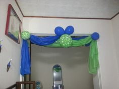 Use plastic table cloths to decorate! Cheap and easy to do!  Got this from another pinner.