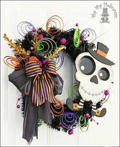 Wreath Craft Ideas - Make a Halloween wreath!  Use a Christmas wreath, spray painted black!