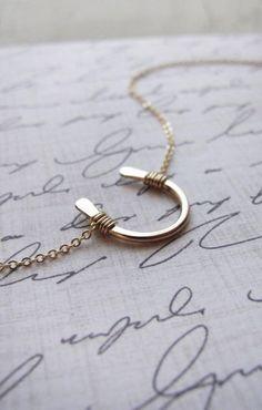 horseshoe necklace.