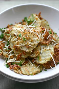 Oven Baked Garlic Parmesan Fries: thinly slice 3 russet potatoes.  Coat sliced potatoes in 2-3 tablespoons of olive oil.  Mix with 1/4 cup panko bread crumbs,  1/4 cup parmesan,  garlic salt, and  fresh ground pepper.  Bake at 450 for about 20 minutes.  FANTASTIC!  10/25/12