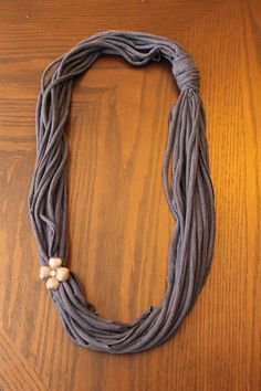tshirt necklace...MY FRIEND MAKES AND SELLS THESE AND ADDS DIFFERENT JEWELRY ACCENTS TO THEM...SUPER CUTE, I WEAR MINE INTERTWINED WITH SCARVES.