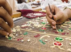 artists working in traditional zardozi embroidery