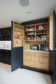 A stunning space of clean symmetry and functionality. Our Challock Kitchen is bold, sociable and impressive by design. The contemporary dark-painted finish of the cabinetry contrasts beautifully with the light white stone worktops and flooring. Featuring a large central island, family-sized larder and a practical Quooker tap, the Challock Kitchen is a wonderful, family-accommodating, open-plan living space - with a subtle show of luxury!