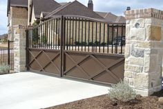 Wrought Iron Entry Dallas Tx by Graves Lawn and Landscape rock garden, driveway idea, wrought iron