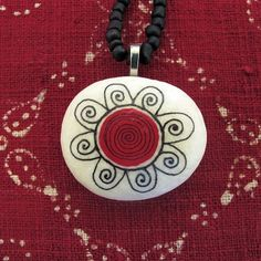 a handmade necklace...  pendant handpainted on a sea-stone from the shores of North Aegean...  chain is made with black Japanese seed beads, finished with a coral hanging from the nape... Aaanraku bails are from ETSY suppliers..  chain length is 36 (45) cm - 14,5 (18) inches..