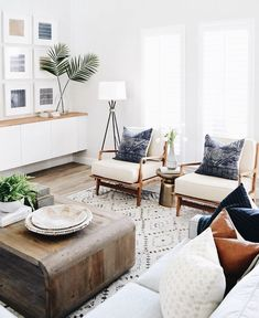 Bohemian living room // light wash hardwood floors // gallery wall // white living room