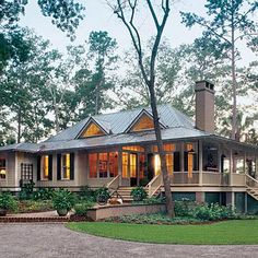 Tideland Haven, Plan #1375 | Sheltered by deep overhangs and a wraparound porch, this award-winning plan is detailed in comfort. | SouthernLiving.com