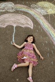 These sidewalk chalk photo ideas would make for an excellent photo album!  Easy and cheap way to make a cute background!