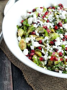 Warm Brussels Sprouts Salad with Pomegranate and Goat Cheese.  This is the BEST side dish ever! Super quick and easy recipe--ready in 20 minutes.