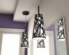 Suspended #fixtures in front of a mirror help reflect the light throughout the room. | Les #suspensions noires se reflètent dans le miroir pour créer l'effet d'une pièce plus lumineuse. #bathroom #salledebains
