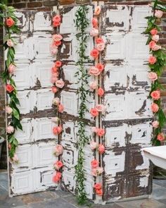 Dress up an antique ceiling tile screen with leafy garland and colorful roses to act as a photobooth backdrop