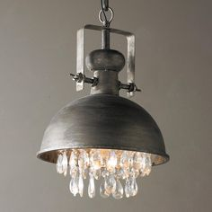 """Industrial Pendant with Crystals This vintage aged steel pendant is warmed by the addition of sparkling faceted crystals underneath for a chic complement to your urban farmhouse, modern industrial or rustic luxe interiors. Includes 31"""" of chain from a 5"""" round canopy. 1-40watt max medium base bulb. (14""""Hx10""""W)"""
