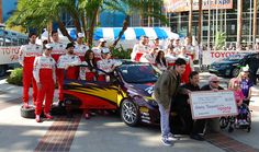 Racing for Kids check presentation at the 2012 Toyota Pro/Celebrity Race in Long Beach. #TPCR