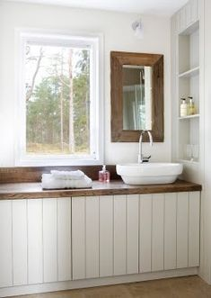 LOVE LOVE LOVE. Simple and cute.  Love the window, the wood counters and mirror.  And the built in shelf.