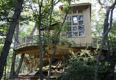 The elaborate treehouse built on Brad and Diane Duesler's property near Barneveld uses seven oak trees and part of a rock formation to support it.