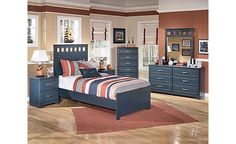 Leo Panel Bedroom Set - give your little man a blue-tone bedroom that he can enjoy for years to come.  -by Ashley Furniture-