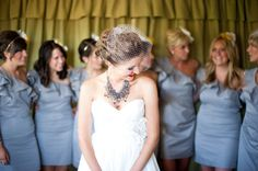 Simple dress. Statement necklace. Birdcage veil. Yes yes yes!