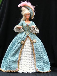 Crocheted nearly 20 years ago. Thread crochet, slightly thicker than sewing thread. very, very, intricate, plus embellishments. I made every single thing, even the hair dressings and hairstyles.