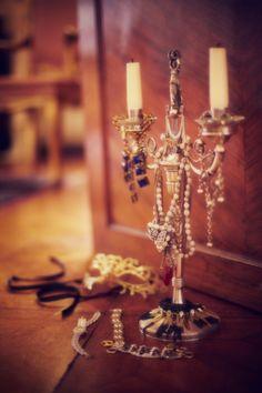 Candelabra draped with jewels for storage/display #closet #dressing_room #jewelry #organization
