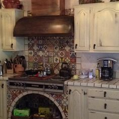 Mexican Talavera tile- I LOVE the mexican tile backsplash in back of stove. It will really give the kitchen a POP and we could decide on subway tile grout accordingly