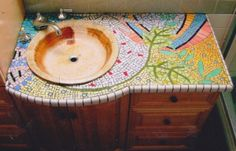 mosaic bathroom countertop with handpainted tile