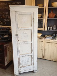 tall cupboard in original white paint
