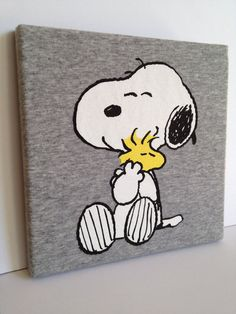 Tshirt Canvas Wall Art  - gonna try this w/ Landon's old Gambler's Hockey sweatshirts for his bedroom