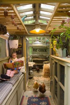A reading nook for humans inside a chicken coop? Why not? | Our favorite chic coops | Living the Country Life | http://www.livingthecountrylife.com/animals/chickens-poultry/our-favorite-chic-coops/