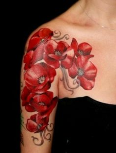 Tattoo of poppies on shoulder. Very cute.