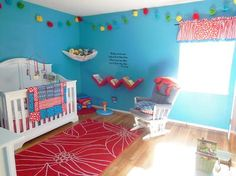 Our baby boy's bright and colorful Cat in the Hat Nursery decor. We came up with the idea for Sebastian's bright and colorful Cat in the Hat nursery theme's color scheme first. My favorite color is turquoise, while my